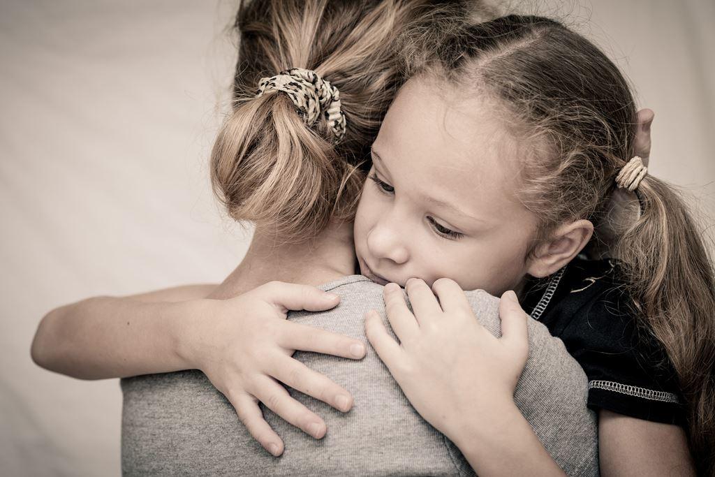 sad-daughter-hugging-his-mother